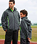 Athlete wearing Green-Lime Track Jackets