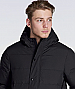 AS Colour: Mens Puffer Jacket #5505 with Logo Service. Zip up hooded down jacket, zip and dome closure at front, 2 side pockets and 1 internal pocket. Heavyweight 90gsm. 100% nylon outer, 80 percent down 20% feather inner panelled body, elasticated sleeve